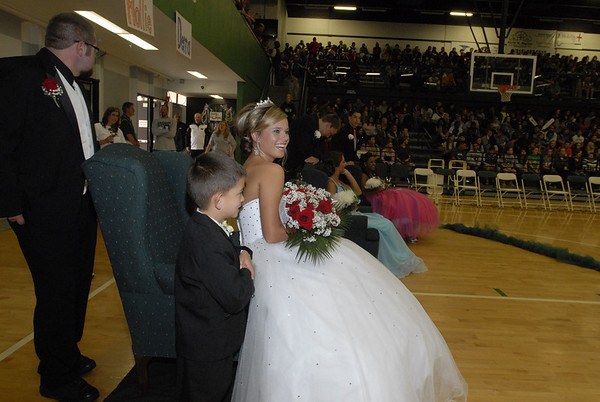 Muskogee High School 2012 Homecoming Queen Hannah Alexander beams after taking her throne at the homecoming coronation. Standing by are escort, J.B. Clark, left, and crown bearer Carson Coleman.