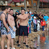 Members of NSU's Phi Sigma Kappa fraternity try to warm up by doing some light stretching. The waters of the river were a bone-chilling 49 degrees, along with a 35 degree air temp.