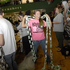 Muskogee High School junior Morgan Springborn adjusts a chain made by the MHS sophomore class to help the school raise money for the Lake Area United Way. The class raised $335 of the total $869 raised by MHS.