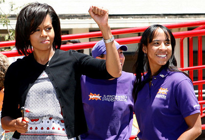Michelle Obama greets volunteers as she arrives to help KaBoom build a kid's playground in a disadvantaged school, June 22, 2009 in San Francisco, Calif.