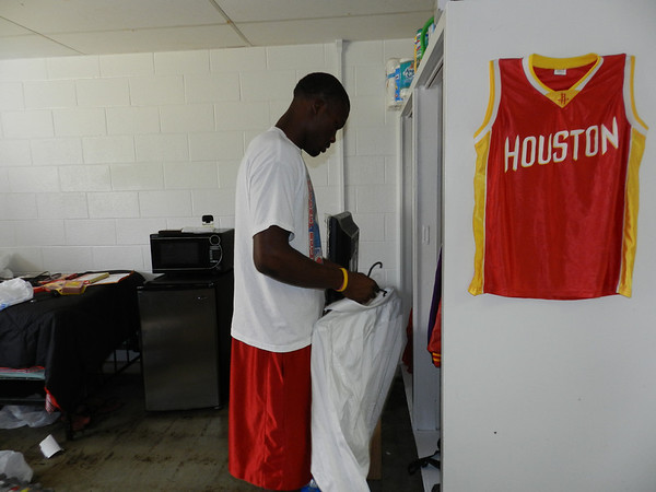 Bacone College freshman Verriel Littleton of Houston hangs his clothes in his dorm room in Posey Hall. Tuesday marked the first day students could move into their rooms.