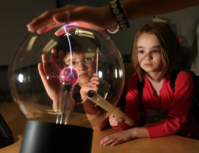 "Kids learn about electricity and Van De Graf generators at ""Take Your Sons and Daughters To Work Day"" at Sandia National Lab in Livermore."