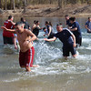 "Employees of the Cherokee Nation Marshals exercise a little revenge on each other during the 2013 ""Polar Plunge"" on Saturday. The marshals raised over $3,000 for the event, which benefits Oklahoma Special Olympians."