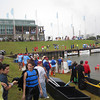 The audience crowds the starting line despite the steady rain Saturday morning for the 2012 River Rumba Regatta.