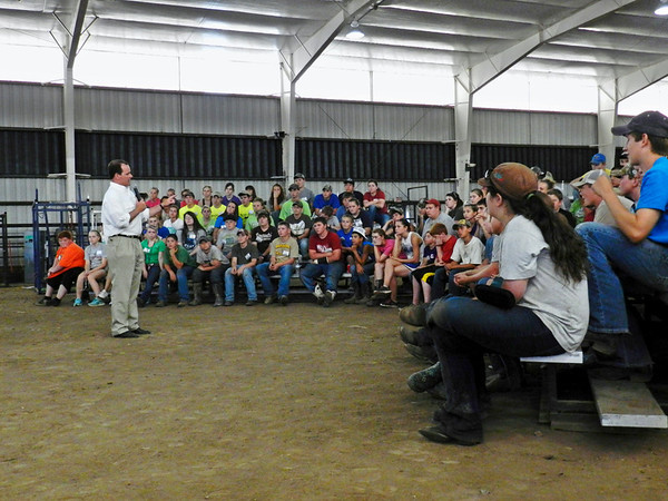 More than 120 children and teenagers from across the United States in a cattle barn at Connors State College in Warner listen to Lt. Gov. Todd Lamb speak about their potential as leaders of agriculture as well as his own leadership experience.<br /> The youngsters are campers at the college's Be a Champ Show Cattle Camp, directed and founded by state Rep. Jerry McPeak, D-Warner. <br /> The camp, led in three sessions about cattle and two about lambs, teaches its campers showmanship, clipping, grooming and feeding techniques.