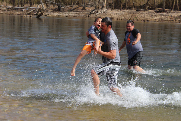 "Traevan Morrison, age 6, gets a little help from his dad Jake Morrison as they run out of the water on Saturday morning. Traevan tied with another boy for being the youngest ""plunger"" to brave the waters."
