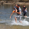 """Traevan Morrison, age 6, gets a little help from his dad Jake Morrison as they run out of the water on Saturday morning. Traevan tied with another boy for being the youngest """"plunger"""" to brave the waters."""