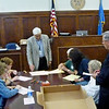 Staff photo by D.E. Smoot<br /> Wagoner County Election Board Secretary Larry Wilkinson, center, oversees the recount of 1,799 ballots cast in the Republican primary runoff election for court clerk.
