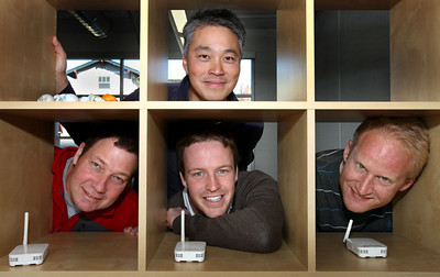 Founders of Euclid Elements of Palo Alto, Ken Leung, top, Steve Wilhelm, Will Smith and Scott Crosby, bottom, who created a data analytics platform for retailers, pose with their sensors.  Silicon Valley-San Jose Business Journal/Dino Vournas
