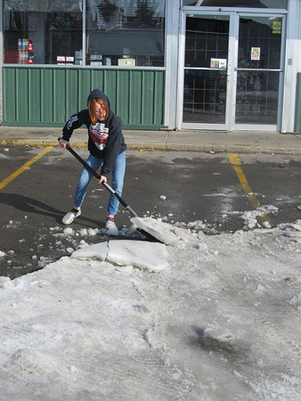 "Kylie Ensminger, 10, spent the day Wednesday clearing ice from the parking lot at Super Quik on East Okmulgee Avenue. The Irving Elementary fourth-grader was spending the day at work with her mom, Reva Ensminger, a cashier at the business owned by Odus Flatt.""I was just trying to help Odus, so nobody gets hurt,"" Kylie said."