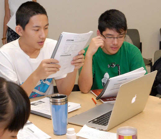 Staff photo by Cathy Spaulding<br /> Frank Xia, left, and Leo Liu from Weifang, China, review English words in an English immersion class at Northeastern State University. The class will help them and 10 other Weifang students take classes at Tahlequah Middle School.