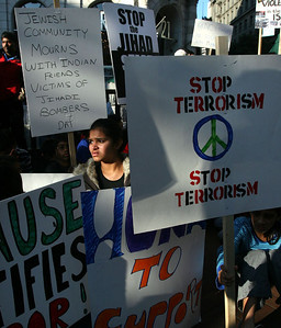 Demonstrators, including Bhavisha Shukla of Cupertino, center, marched and then sat down on the Market Street sidewalk in San Francisco, Sunday, Nov. 30, 2008 in condemnation of the terrorist killings in Mumbai, India.  (AP Photo/Dino Vournas)