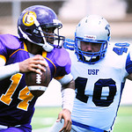 Texas College QB Aaron Washington tries to escape St. Francis defensive end Zach Bruce in the seson opener at Trinity Mother Frances Rose Stadium Saturday afternoon. Herb Nygren Jr 082512