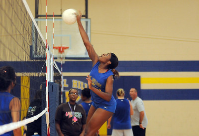 copyright 2012 Sarah A. Miller/Tyler Morning Telegraph  Chapel Hill High School volleyball junior Shay Ross spikes the ball during practice Thursday afternoon August 9.