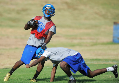 John Tyler's DeQuante Woods begins the 2012 football season with their first practice Monday monring. Herb Nygren Jr