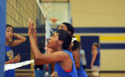 copyright 2012 Sarah A. Miller/Tyler Morning Telegraph  Chapel Hill High School volleyball senior Derrica Campbell waits for a block during practice Thursday afternoon August 9.