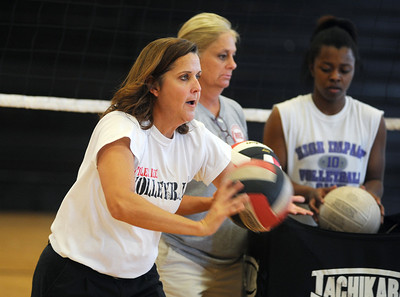 copyright 2012 Sarah A. Miller/Tyler Morning Telegraph  Robert E. Lee High School volleyball coach Melissa Lee runs a bumping drill with her players as they practice Monday afternoon.
