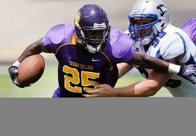 Texas College QB Devin Lee tries to escape from St Francis' tackle Matt Cardenin the seson opener  at Trinity Mother Frances Rose Stadium Saturday afternoon. Herb Nygren Jr 082512