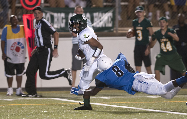 John Tyler's Damion Miller (8) tries to stop Longview's Tylan Miller (5) just before he scores a touchdown during the Trinity Mother Frances Football Classic Saturday night.  (Sarah A. Miller/Tyler Morning Telegraph)