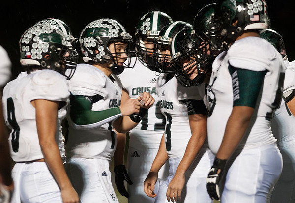 Bishop Thomas K. Gorman's quarterback Michael Goodwin, second from left, talks with his teammates during their game at Grace Community School Friday Nov. 6, 2015.  (Sarah A. Miller/Tyler Morning Telegraph)