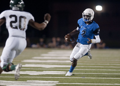 John Tyler's Bryson Smith carries the ball during their game against Longview in the Trinity Mother Frances Football Classic Saturday night.  (Sarah A. Miller/Tyler Morning Telegraph)