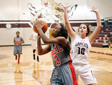 Robert E. Lee's (3) Miyah Pettigrew shoots as Whitehouse's (10) Brittany Taylor defends Tuesday night at Whitehouse High School during the girls basketball season opener.  (Sarah A. Miller/Tyler Morning Telegraph)
