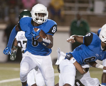 John Tyler's Damion Miller (8) carries the ball during their game against Longview in the Trinity Mother Frances Football Classic Saturday night.  (Sarah A. Miller/Tyler Morning Telegraph)
