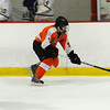 Evan Barber skates the puck up the boards