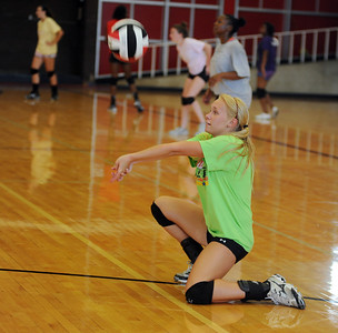 copyright 2012 Sarah A. Miller/Tyler Morning Telegraph  Robert E. Lee High School junior Nicole Trpkosh bumps the volleyball during practice Monday afternoon.