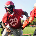 Lee's Etim Asangansi runs a defensive line drill at the  Red Raiders first practice Monday morning. Herb Nygren Jr 081312