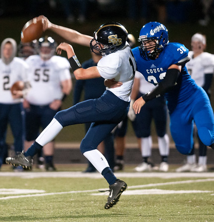 Grace Community School's Drew Cotton takes down Houston Second Baptist's quarterback Zach Heaton Friday Nov. 13, 2015. Grace won, 28-18.  (Sarah A. Miller/Tyler Morning Telegraph)