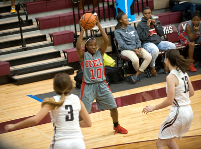 Robert E. Lee's (10) Tyreesha Blaylock looks to pass the ball Tuesday night at Whitehouse High School during the girls basketball season opener.  (Sarah A. Miller/Tyler Morning Telegraph)