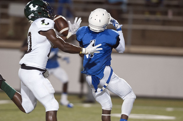 John Tyler's Duntayviun Gross (1) fumbles the ball with Longview's Traveion Webster (10) right behind him during the Trinity Mother Frances Football Classic Saturday night.  (Sarah A. Miller/Tyler Morning Telegraph)