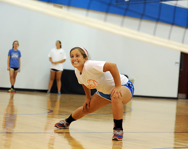 copyright 2012 Sarah A. Miller/Tyler Morning Telegraph  All Saints High School volleyball junior Maddie Smith does a warm up  Wednesday during practice.