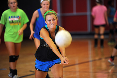 copyright 2012 Sarah A. Miller/Tyler Morning Telegraph  Robert E. Lee High School senior Gentry Townsend bumps the volleyball during practice Monday afternoon.