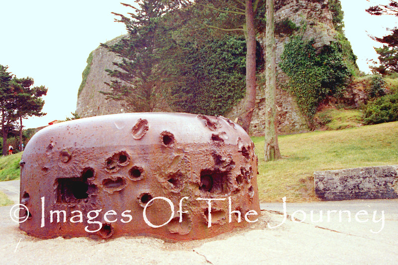 This German pillbox is actually in St. Malo but it so demonstrates the violence of the invasion.  These are the results of American Tanks taking on a German machine gun pillbox. It is close to 25 cm thick steel. It is interesting to note that there is only one hole which penetrated the metal.
