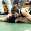 Elyria Catholic's Tyler Filiaggi pins North Ridgeville's David DiFilippo in 152 wt. class on Jan. 11.   Steve Manheim