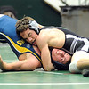 Elyria Catholic's Jerot Schill, top defeats North Ridgeville Tommy Wendling in 145 wt. class on Jan. 11.   Steve Manheim