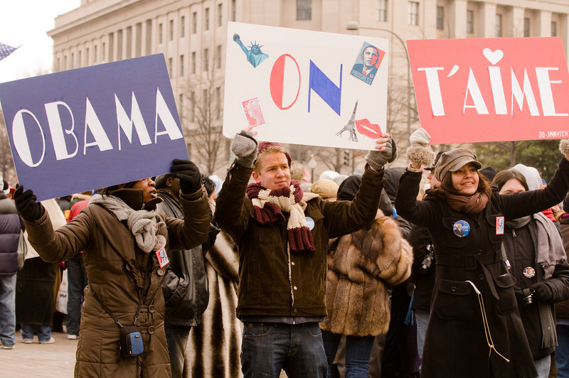 """Obama, on t'aime"" - People shots posing for the MSN NBC's media stand right along Pennsylvania Avenue."
