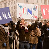 """""""Obama, on t'aime"""" - People shots posing for the MSN NBC's media stand right along Pennsylvania Avenue."""
