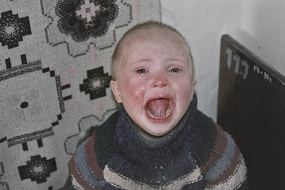 Crying child in Orphanage - Eastern Europe. Copyright © Alex Emes
