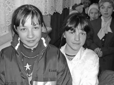 Sisters. Social orphans, in Ukraine orphanage, wearing donated clothing from America. Copyright © Alex Emes