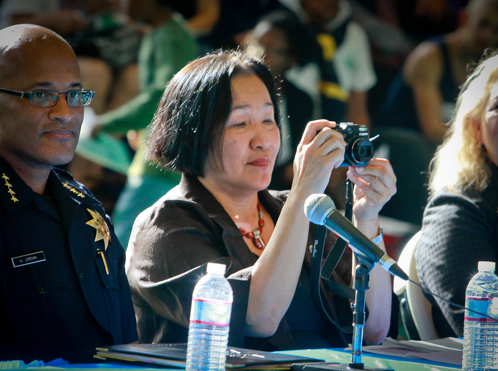 Oakland Mayor Jean Quan takes a picture during a presentation of a new crime prevention plan at Laney College in Oakland, Calif., on Thursday, October 15, 2011.