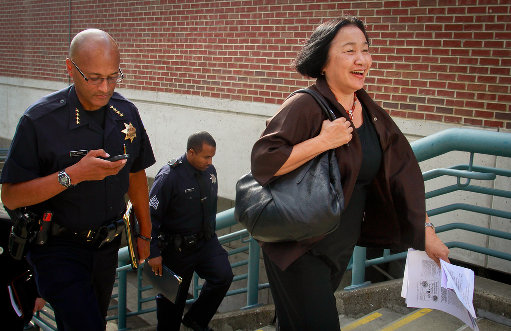 Oakland Mayor Jean Quan walks with interim Police Chief Howard Jordan after  the presentation of a new crime prevention plan at Laney College in Oakland, Calif., on Thursday, October 15, 2011.