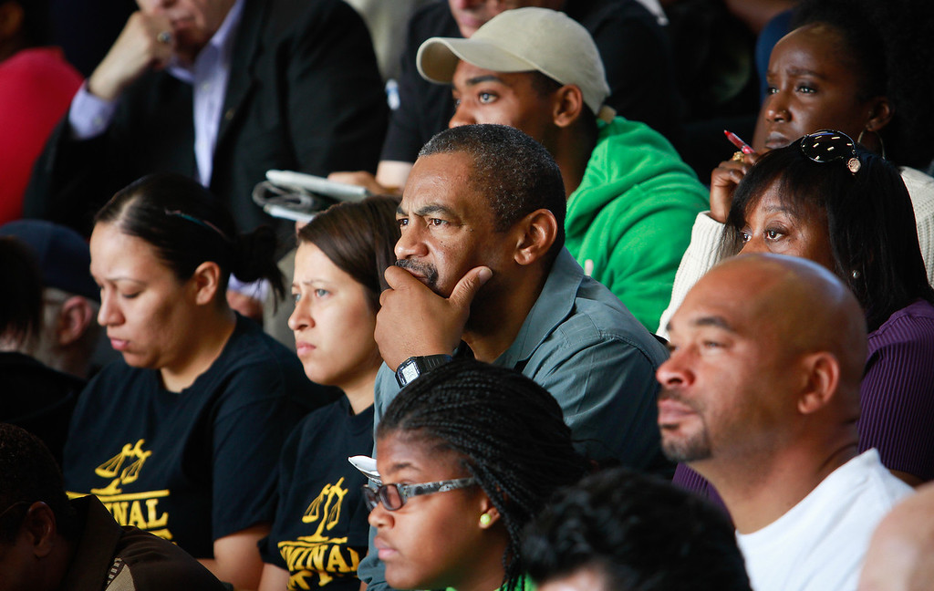 Residents listen to Oakland Mayor Jean Quan announcing a new crime prevention plan at Laney College in Oakland, Calif., on Thursday, October 15, 2011.