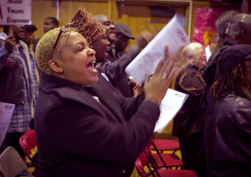 Deanita Lewis claps during a memorial for those harmed by gun violence at Greenleaf Elemantary School in Oakland, Calif., on Friday, December 9th,  2011.