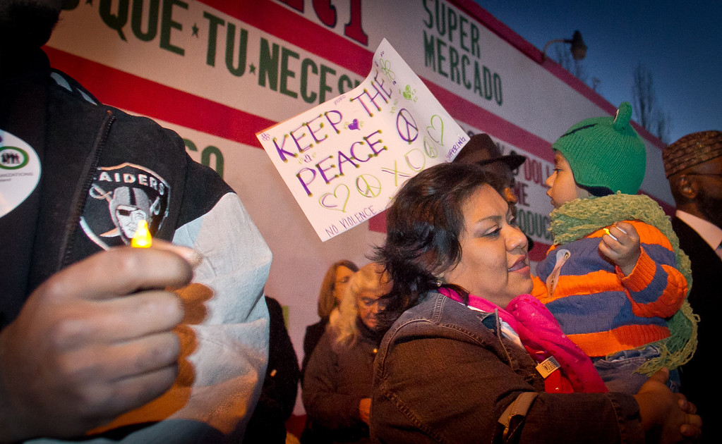 Bernice Guzman with her son Esoras ,3, at the Memorial & Peace Walk for those harmed by gun violence in Oakland, Calif., on Friday, December 9th,  2011.