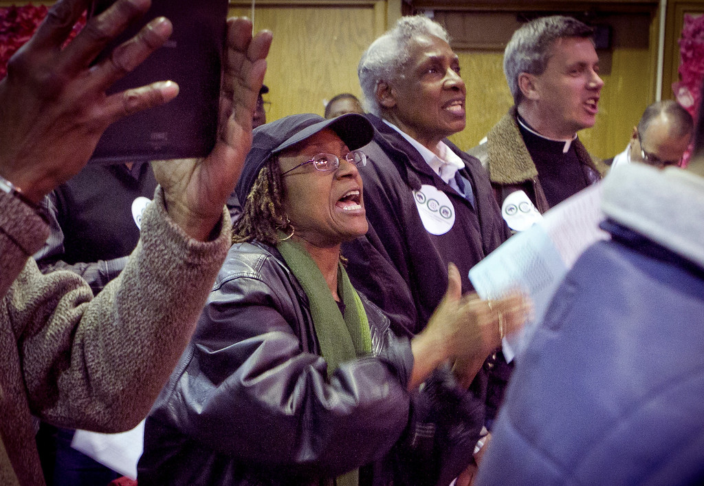 People sing songs during a memorial for those harmed by gun violence at Greenleaf Elemantary School in Oakland, Calif., on Friday, December 9th,  2011.