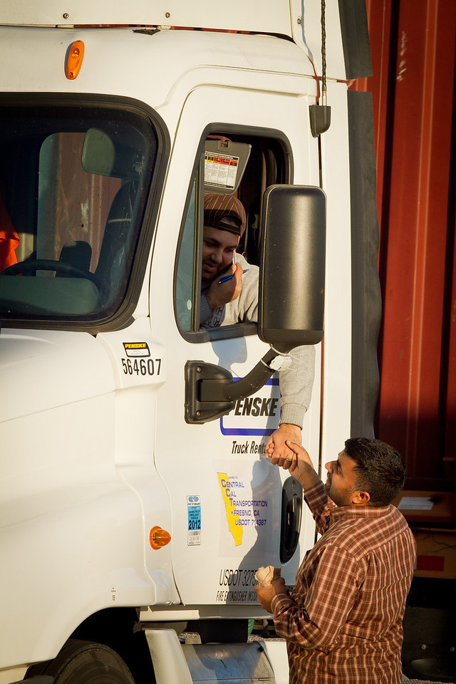 Two truck drivers greet each other at the Port of Oakland in Oakland, Calif., on Friday, December 9, 2011. Story about how Occupy Oaklland plans to shut down the port on December 12th.