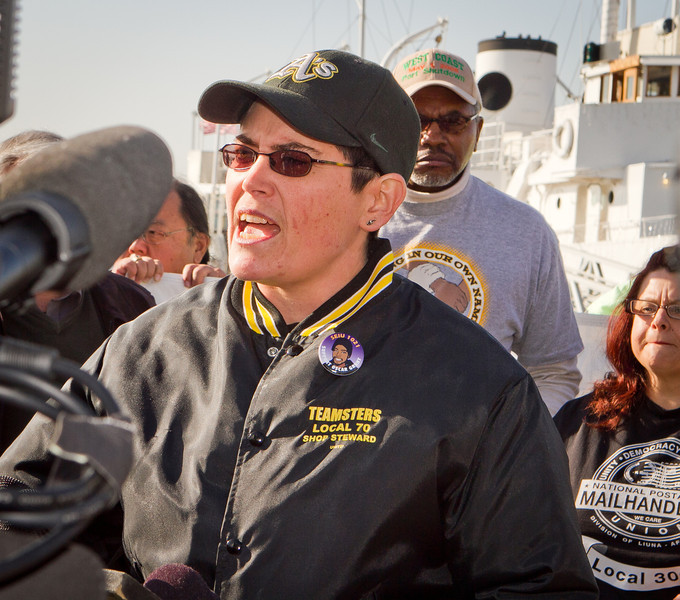 Teamster Jenna Woloshyn speaks at a press conference organized by Occupy Oakland on plans about shutting down the Port of Oakland in Oakland, Calif., on Friday, December 9, 2011.
